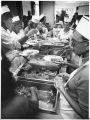 Volunteeers serve Thanksgiving dinner at the Saint John's soup kitchen, Santa Fe, New Mexico