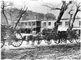 Wagons loaded with firewood on Palace Avenue looking southwest, Santa Fe, New Mexico