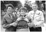 Jewelry collector Willow Fitch with her parents Willow and Charlie Byrd at Indian Market, Santa...