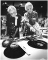 Miriam Porter, left and Emily Tefft view pottery and jewelry winners at Indian Market, Santa Fe,...