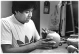Alvin Curran, Ohkay Owingeh Pueblo, carves a design into a pot