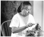 Jody Folwell, potter, Santa Clara Pueblo, working in her kitchen