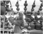 Sarah Newton looks at pots for sale at Jackalope in Santa Fe