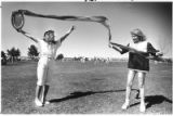 Kristeena Watson and Beth Phillips play with a long-tail kite