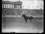 Tom Elder doing a headstand on horseback, Soldier Field, Chicago, Illinois