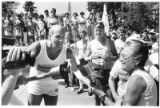 Stephen Drogin passes the flame of the Olympic torch to Bess James at the plaza, Santa Fe, New...