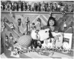 Michelle Naranjo displays Christmas ideas at Wheelwright Museum, Santa Fe, New Mexico