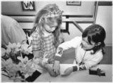 Emma Bunkley, left, and Sarah Cady Sartorius, participate in children's activities at the Museum...