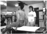 Teacher Dorothy Martinez supervises physical education at the State School for Boys, Springer, New...