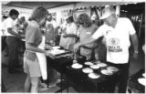 Volunteers for United Way serve pancakes on July 4th on the plaza, Santa Fe, New Mexico
