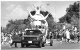 "Parade in downtown Santa Fe kicks off Rodeo de Santa Fe, featuring ""El Toro,"" mascot of..."