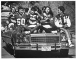St. Michael's High School cheerleaders and students ride in a parade, Santa Fe, New Mexico