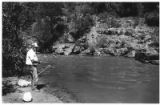 Man fishes on the Pecos River, Pecos, New Mexico