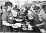 Mary Lee and Don Barcheck volunteer for United Way serving pancakes on the plaza, Santa Fe, New...