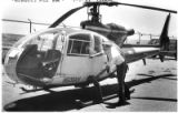 John Denko Jr., of the New Mexico State Police, inspects a bullet hole in a getaway helicopter...