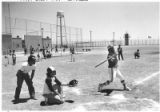 Inmates play softball at the Penitentiary of New Mexico, Santa Fe