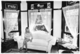 Marie Binneweg in living room of historic Preston House, 106 Faithway Street, Santa Fe
