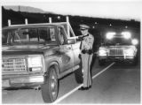 David Yount, Santa Fe County Reserve Sheriff's Officer, stops a vehicle at a checkpoint