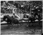 A fast change cowgirls relay race, Tex Austin's Rodeo, Chicago, Illinois