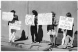 From left: Lynn SMith, Amy Bunting, Rosemary Lowe and Sunny Biossat protest sale of timber...