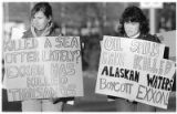 Christina Sorden, left, and Christy Wickman protest the massive Exxon oil spill in Alaska