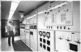 Bruce Korr, water systems operator, at the water treatment controls of the Public Service Company...