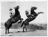 """Canadian Cowgirls Caper on Wild Horses"" noted cowgirls Viola Breckemridge and Barbara..."