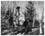 W. Herbert Dunton on horseback in mountains near Taos, New Mexico