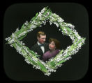 Man and woman framed by white flowers
