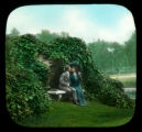 Man and woman kissing on bench