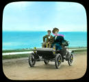 Couple in automobile on beach