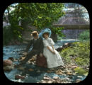 Couple sitting near creek
