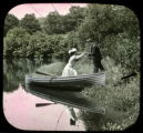 Romantic scene, man helping woman out of canoe