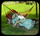 "Couple in hammock, song slide illustration for ""Honey on our Honeymoon"""
