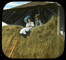 Couple sitting on hay stack