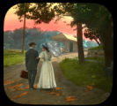 Couple near train depot at sunset