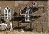 Cornerstones Community Partnerships and local volunteers replastering San Rafael Church during a...