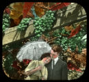 Couple under grape arbor, woman holds parasol
