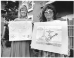 Chrysa Wikstrom and Peggy Long display winners in the community recycling art contest, Santa Fe,...