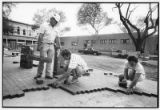 Workers lay a new brick sidewalk along Washington Avenue, Santa Fe, New Mexico