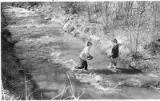 Children playing in the Santa Fe River, Santa Fe, New Mexico