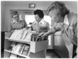 Members of the St. Vincent Hospital Auxiliary look through magazines, Santa Fe, New Mexico