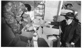 George Ortega and Captain Marv Samuelson conduct the Salvation Army food drive, Santa Fe, New...