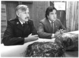 Salvation Army Captain Richard Greene and Congressman Bill Richardson with hams donated for...