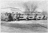 Headstart program employees and busses outside Manderfield School, Santa Fe, New Mexico