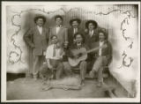 Group of men, including musicians, New Mexico?