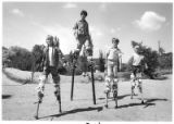 Children play on stilts, Santa Fe, New Mexico