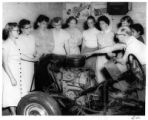 Women drivers learning about engines, New Mexico