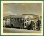 Three men posing with school bus for Eunice School District No. 8, on old US-85 / NM State Road 10...