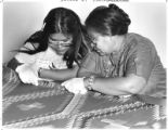 Sarah H. Adetz and Katie C. Henio examine a weaving at School of American Research, Santa Fe, New...